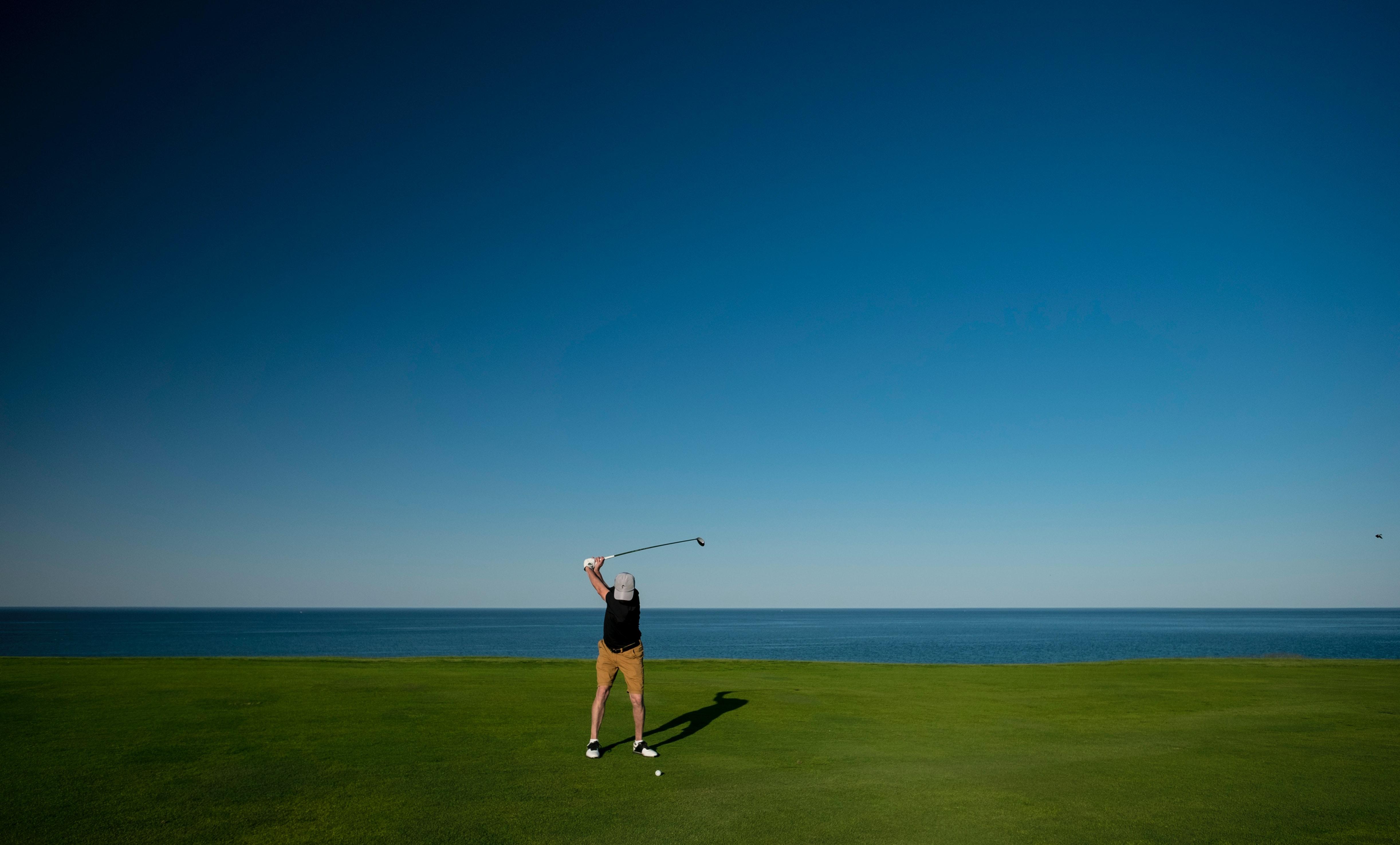 Man Golfing in Whistling Straits